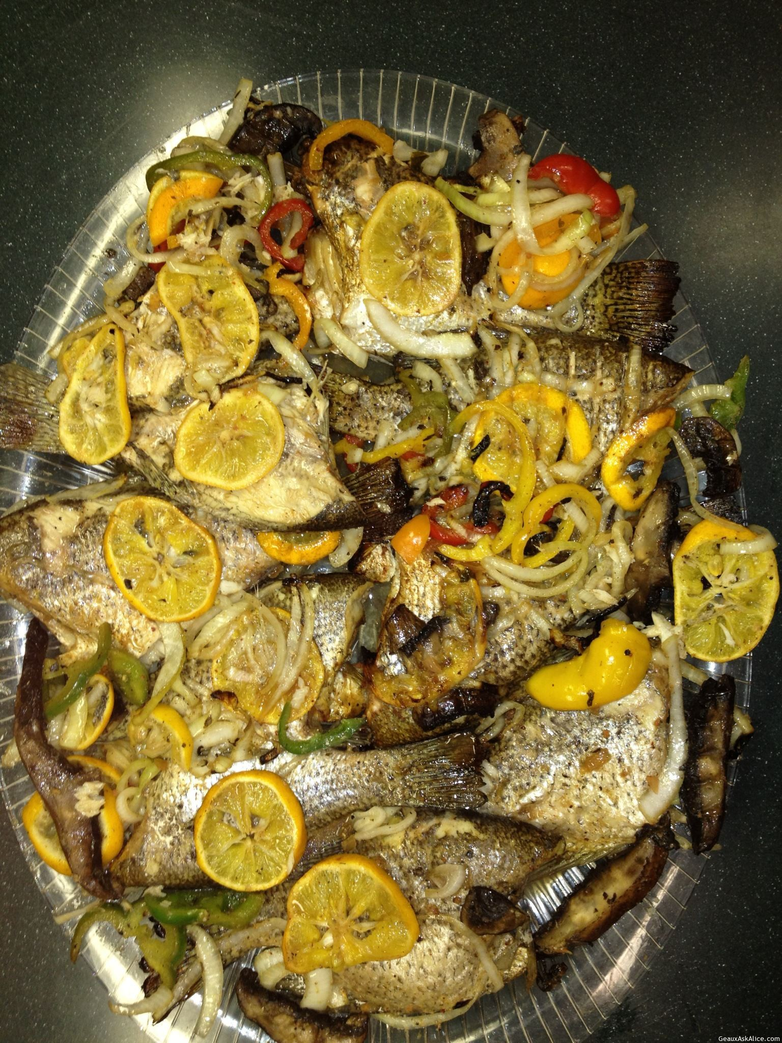 Grilled Fish With Lemons, Mushrooms, Bell Peppers & Onions