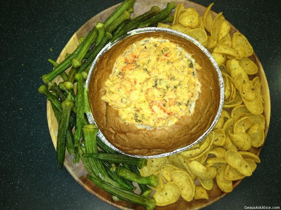 Crawfish Au Gratin Dip In Bread Bowl With Corn Chips And Pickled Okra