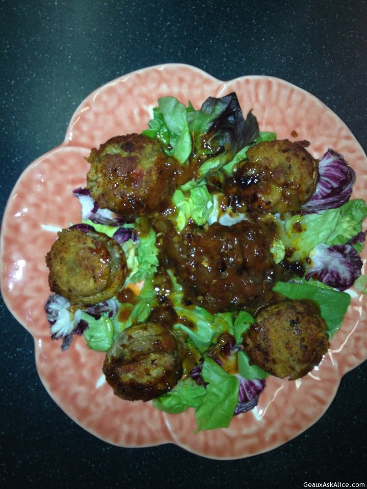 Plate With Stuffed Mushrooms On A Bed Of Lettuce