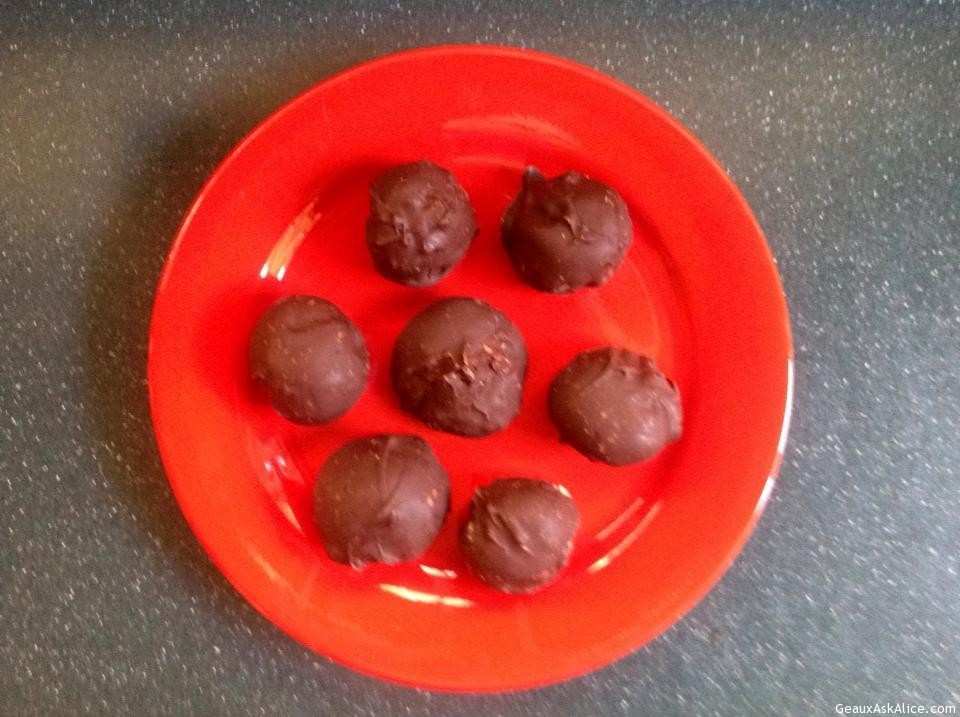 Red Plate With Chocolate Covered Peanut Butter Balls