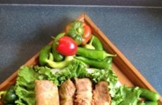 4 Cabbage Rolls On A Bed Of Lettuce With Peppers For Accent