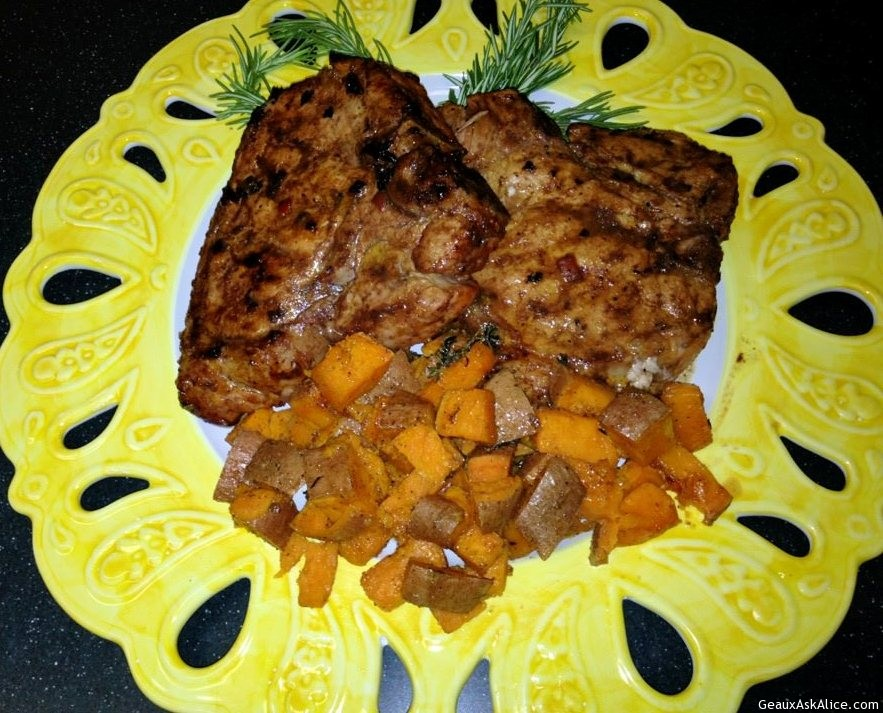 Bone In Rib Pork Chop Plated Up With Yams And
