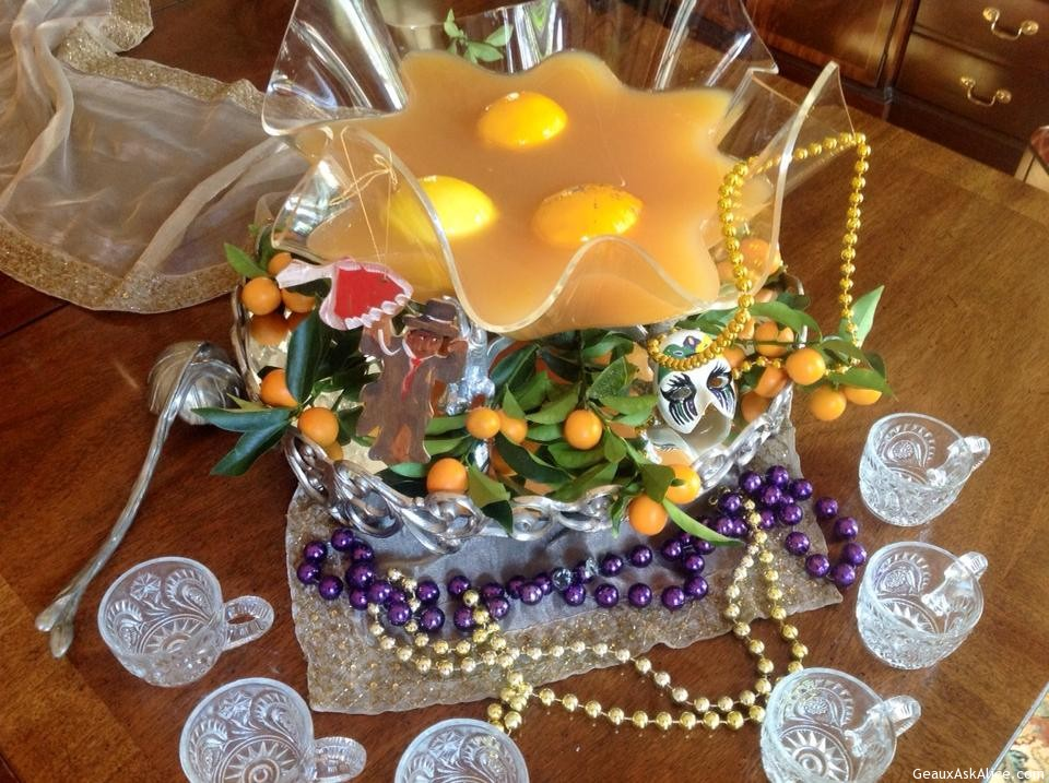 Beautifully Displayed Bowl Of Punch With Mardi Gras Decorations