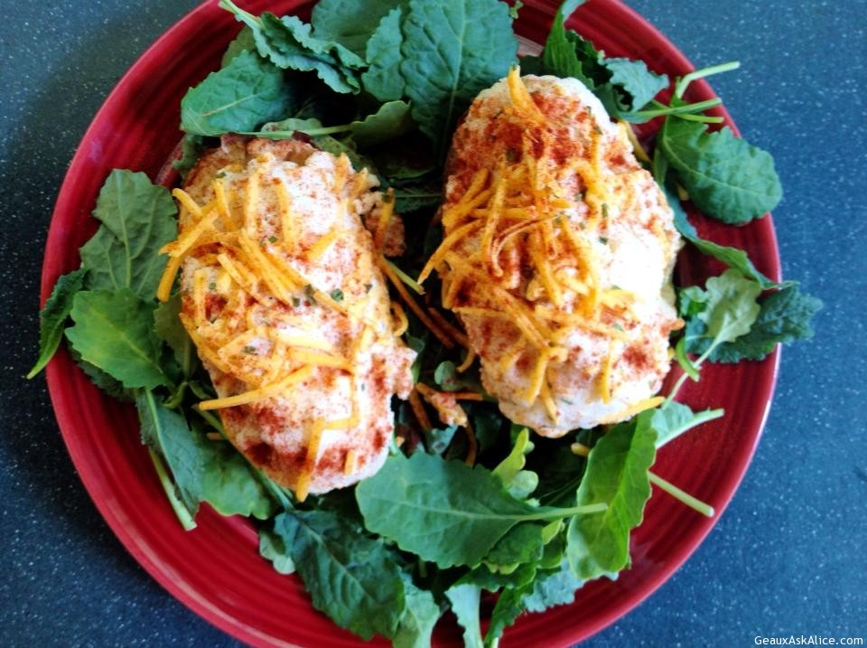 Stuffed Potatos Plated Up On A Bed Of Lettuce.
