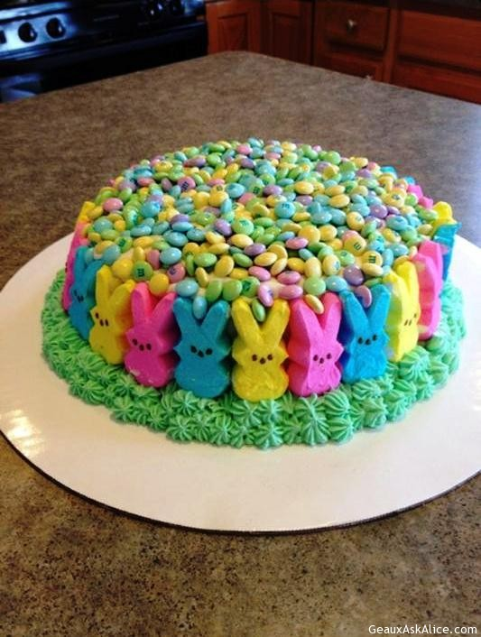 Easter Cake With M&ms On Top And Peep Bunnies All Around Sides.