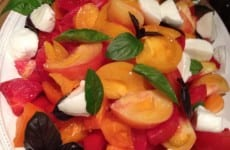 Dish of Heirloom Tomato Salad with Basil and Mozzarella
