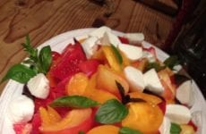 Dish Of Heirloom Tomato Salad With Basil And Mozzarella