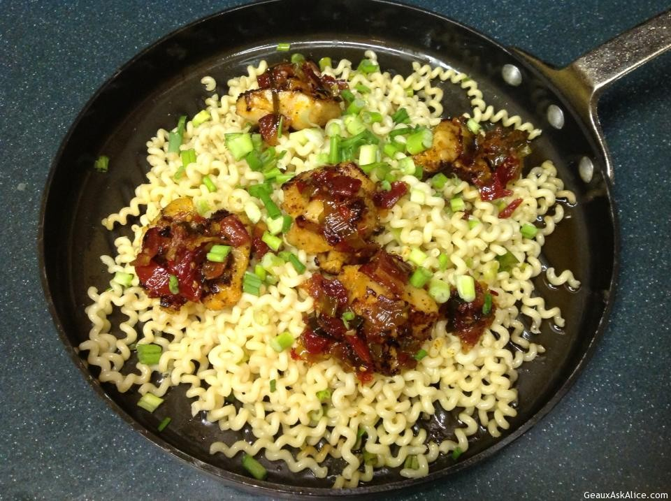 Skilled Filled With Jumbo Grilled Scallops With Bacon, Sun-Dried Tomato And Leek Topping Over Pasta