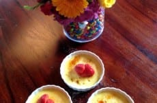 Three cups of Creme Brulee on a table.