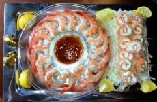 Smoked Salmon Cheese Swirls on a platter with Boiled Shrimp and sauce