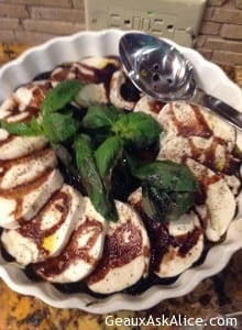 Fresh Slices of Mozzarella with Balsamic Reduction Sauce and Fresh Basil