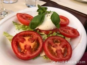 Our lunch today. Kids loving Caprese Salads