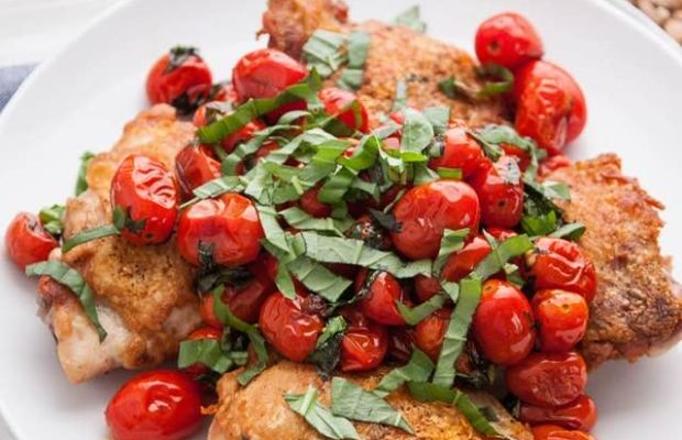 Crispy Pan-Seared Chicken Thighs With Blistered Cherry Tomatoes