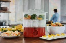 Today's Gadget Is GINNY'S FOOD STEAMER! Steam Meat And Veggies With Ease. It Can Even Cook 12 Eggs At A Time. It Includes A Heating Base, 2 Steamer Baskets And A Lid, A 60-minute Timer, 400 Watts. Baskets And Lid Are Dishwasher Safe. They Sell Anywhere From $25-$35.